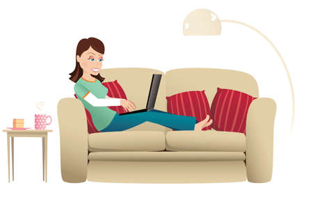 lounging: A woman sitting on her sofa at home, while using her computer.