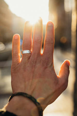 Beautiful hand with the ring and the sunlight Stock Photo