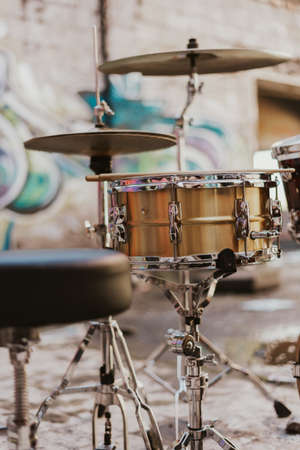 Pretty drummer with drumsticks in an underground environment Stock Photo