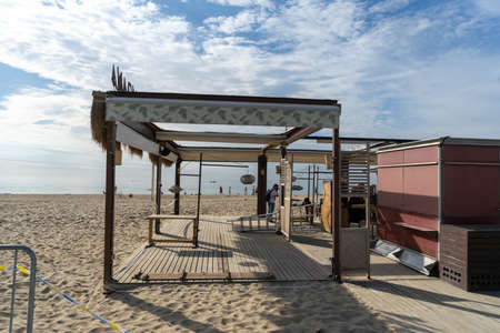 BARCELONA; SPAIN - MAY 25th 2020: First day of the phase 1 of the coronavirus disease (COVID-19) in Barcelona, terrace of one of the few beach bars that today open to the public Editöryel
