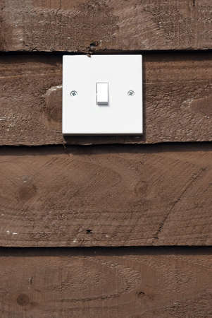 free stock: Royalty free stock image of white light switch against wood background with copyspace beneath
