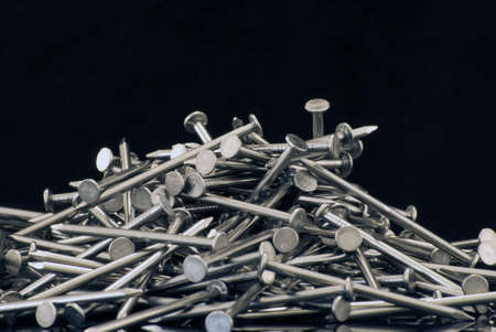 free stock: Royalty free stock image close up of a pile of nails against black providing copyspace above Stock Photo