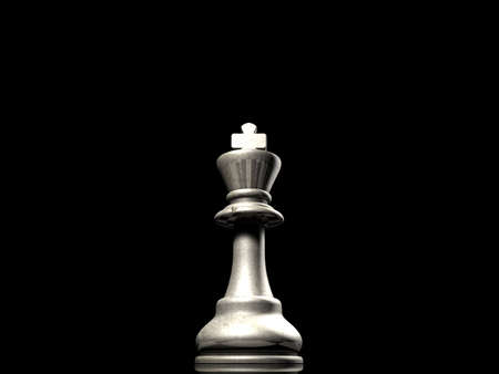 foremost: looking up at a king chess piece against a black background