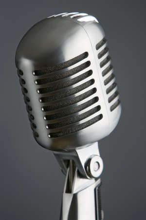 professional studio microphone on the stand on dark gray background