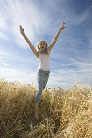 beautiful girl in the wheat field Stock Photo