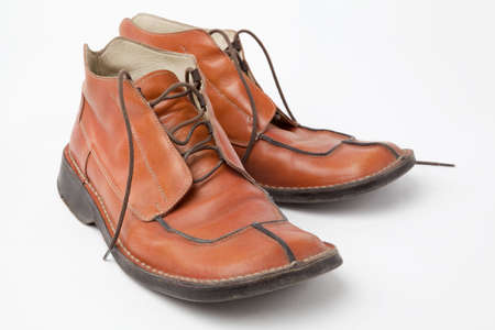 old orange used mens shoes on white background