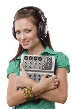 amazing beautiful girl with professional studio headphones on white background in studio shooting  Stock Photo