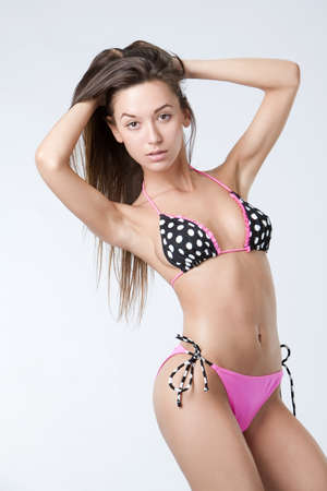 one beautiful girl in swimsuit at one studio shooting Stock Photo