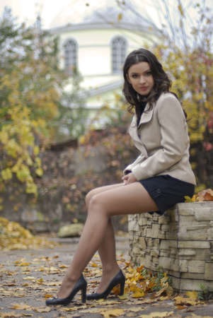young beautiful girl with positive expression in outdoor shooting