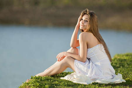 beautiful girl in white dress at outdoor shooting