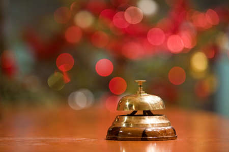 bellman: old hotel bell on a wood stand at Christmas holyday Stock Photo