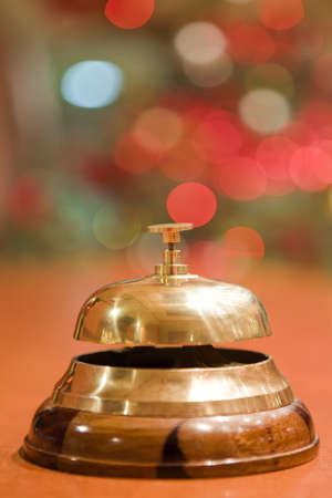 old hotel bell on a wood stand at Christmas Stock Photo