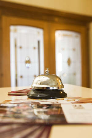 reception counter: hotel bell on a wood stand