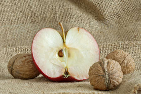 a beautiful red apple with nuts on canvas bag Stock Photo - 11221765
