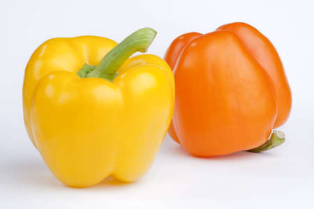 green and yellow pepper isolated on a white background  Stock Photo