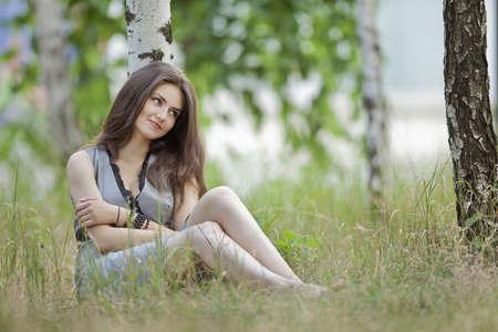 a beautiful girl in grey in an outdoor shooting
