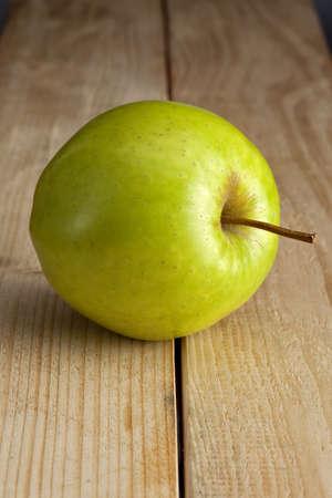 green apple on wood Stock Photo