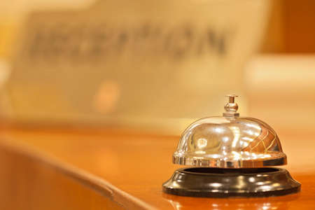 hotel service: old hotel bell on a wood stand