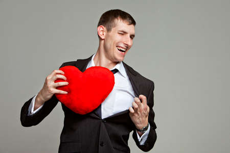 a young man with a red heart
