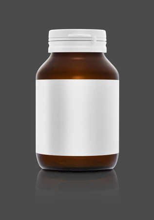 blank supplement bottle with white label isolated on gray background Stock Photo