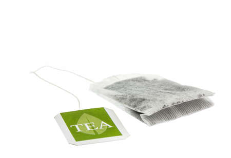 sachet: Tea paper sachet with green label isolated on white background Stock Photo