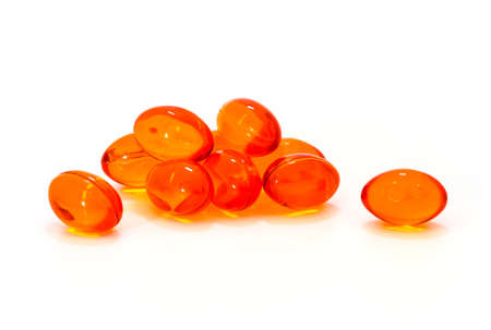 reliever: Red supplement capsules isolated on white background
