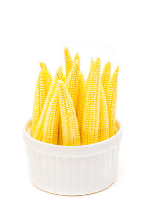Baby corn in a cup isolated on white background