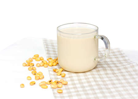 Soy milk with soy bean isolated on white background