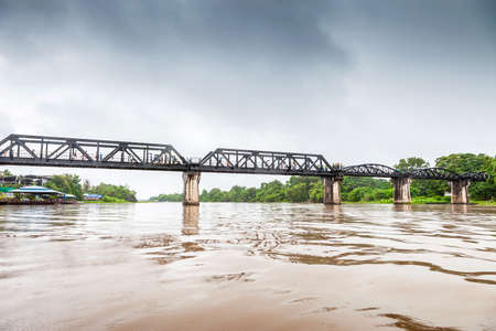 railway history: Railway Bridge of world war history in the rain, River Kwai, Kanchanaburi, Thailand