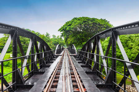 railway history: Railway metal bridge of world war history, River Kwai, Kanchanaburi, Thailand Stock Photo