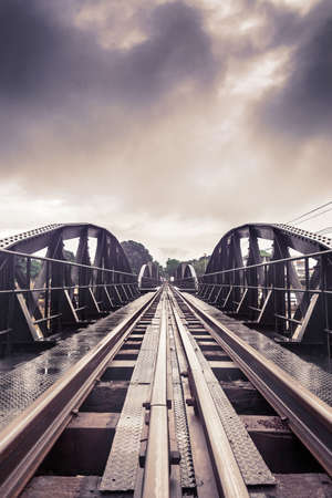 railway history: Railway metal bridge of world war history in vintage tone, River Kwai, Kanchanaburi, Thailand