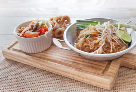 Thai food, fried noodles Thai style with papaya salad and pork crackling, name in Thai is Phat Thai and Somtum