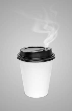 blank hot coffee cup with steam isolated on gray background Stock Photo