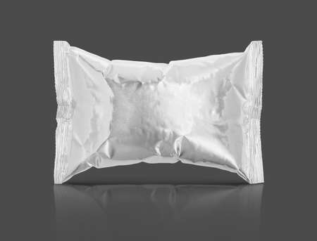 blank packaging aluminum foil snack pouch isolated on gray background