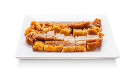 pigskin: crispy pork slice, thai food on dish isolated on white background Stock Photo