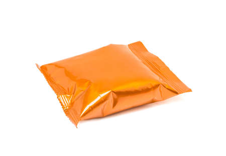 blank packaging orange aluminum foil snack pouch isolated on white background Stock Photo