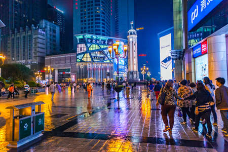 Chongqing, China - September 18, 2015: At Night, People walking in downtown business center of Chongqing, Chongqing is the largest direct-controlled municipality and comprises 19 districts, 15 counties and 4 counties. Editorial