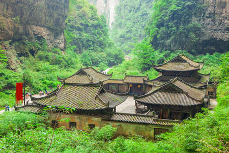 Antique Chinese historical tavern in valley, an important constituent part of the Wulong Karst World Natural Heritage, Chongqing, China
