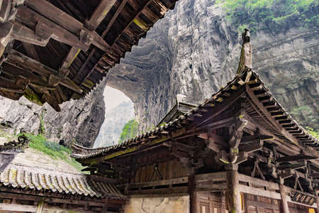 world natural heritage: Roof top of Antique Chinese historical tavern in valley, an important constituent part of the Wulong Karst World Natural Heritage, Chongqing, China
