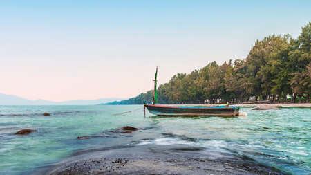 sea in the morning sunrise with small fishing boat, rayong province thailand