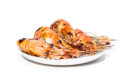 Roasted Prawn delicious seafood in white plate isolated on white background, ready for eat Stock Photo