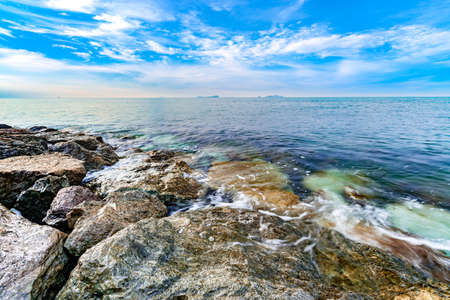 calmness seashore with clear water and cloudy blue sky Stock Photo