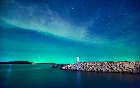 starry night: Beautiful calmness starry night sky with cloudy and colorful light at seashore pier of Khao Laem Ya National Park, Rayong province eastern Thailand