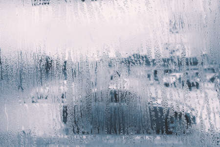 raindrops on glass window in rainy season with monotone Stock Photo