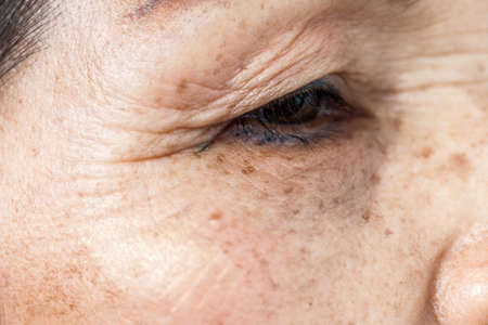 wrinkled old asian woman skin texture in selective focus