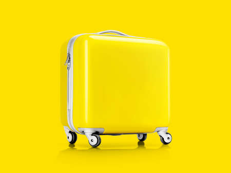 Yellow plastic suitcase or luggage for traveler isolated on yellow background with clipping path