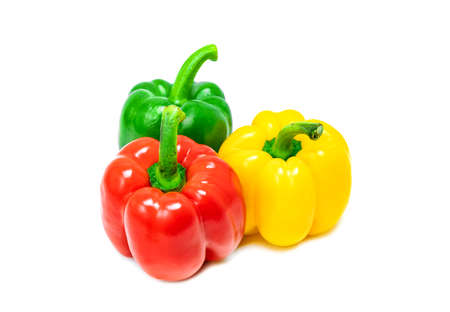 fresh vegetable bell peppers in three colored red, green, yellow like reggae color style isolated on white background