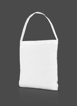 blank white canvas shopping tote bag for save global warming isolated on gray background with clipping path
