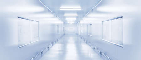 modern interior science laboratory or factory walkway background with fluorescent lighting in monotone