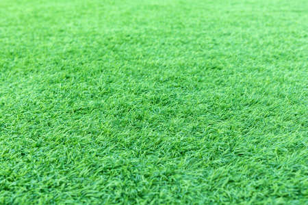 Dept of field with artificial green grass or astroturf for background